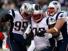 EAST RUTHERFORD, NJ - DECEMBER 21: Defensive tackle Vince Wilfork #75 of the New England Patriots celebrates with defensive end Chandler Jones #95 against the New York Jets during a game at MetLife Stadium on December 21, 2014 in East Rutherford, New Jersey.  (Photo by Jeff Zelevansky/Getty Images)