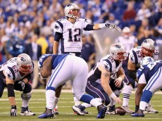 INDIANAPOLIS, IN - NOVEMBER 16:  Quarterback Tom Brady #12 of the New England Patriots reacts against the Indianapolis Colts during the game at Lucas Oil Stadium on November 16, 2014 in Indianapolis, Indiana.  (Photo by Andy Lyons/Getty Images)