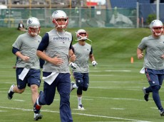 FOXBOROUGH, MA - JUNE 4: Tom Brady #12 of the New England Patriots, jogs during organized team activities at Gillette Stadium on June 4, 2015 in Foxborough, Massachusetts. (Photo by Darren McCollester/Getty Images)