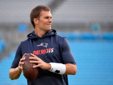 CHARLOTTE, NC - AUGUST 28:  Tom Brady #12 of the New England Patriots warms up before playing the Carolina Panthers during their preseason NFL game at Bank of America Stadium on August 28, 2015 in Charlotte, North Carolina.  (Photo by Grant Halverson/Getty Images)