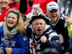 Oct 26, 2014; Foxborough, MA, USA; New England Patriots fans celebrate from the stands during the fourth quarter against the Chicago Bears at Gillette Stadium.  The Patriots won 51-23.  Mandatory Credit: Greg M. Cooper-USA TODAY Sports