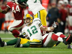 GLENDALE, AZ - DECEMBER 27:  Quarterback Aaron Rodgers #12 of the Green Bay Packers reacts after fumbling the football, recovered by the Arizona Cardinals during the third quarter NFL game at the University of Phoenix Stadium on December 27, 2015 in Glendale, Arizona. The Cardinals defeated the Packers 38-8.   (Photo by Christian Petersen/Getty Images)