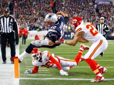 FOXBORO, MA - JANUARY 16:  Tom Brady #12 of the New England Patriots dives for the endzone in the second quarter against Husain Abdullah #39 and Tyvon Branch #27 of the Kansas City Chiefs during the AFC Divisional Playoff Game at Gillette Stadium on January 16, 2016 in Foxboro, Massachusetts.  (Photo by Al Bello/Getty Images)
