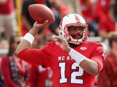 RALEIGH, NC - OCTOBER 31:  Jacoby Brissett #12 of the North Carolina State Wolfpack warms up before their game against the Clemson Tigers at Carter-Finley Stadium on October 31, 2015 in Raleigh, North Carolina.  (Photo by Streeter Lecka/Getty Images)