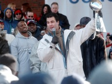 400603 06: Winning field goal kicker Adam Vinatieri hoists the Superbowl trophy February 5, 2002 following a victory parade in Boston, MA. The Patriots beat the heavily favored St. Louis Rams Sunday to win their first ever Superbowl title. (Photo by Darren McCollester/Getty Images)