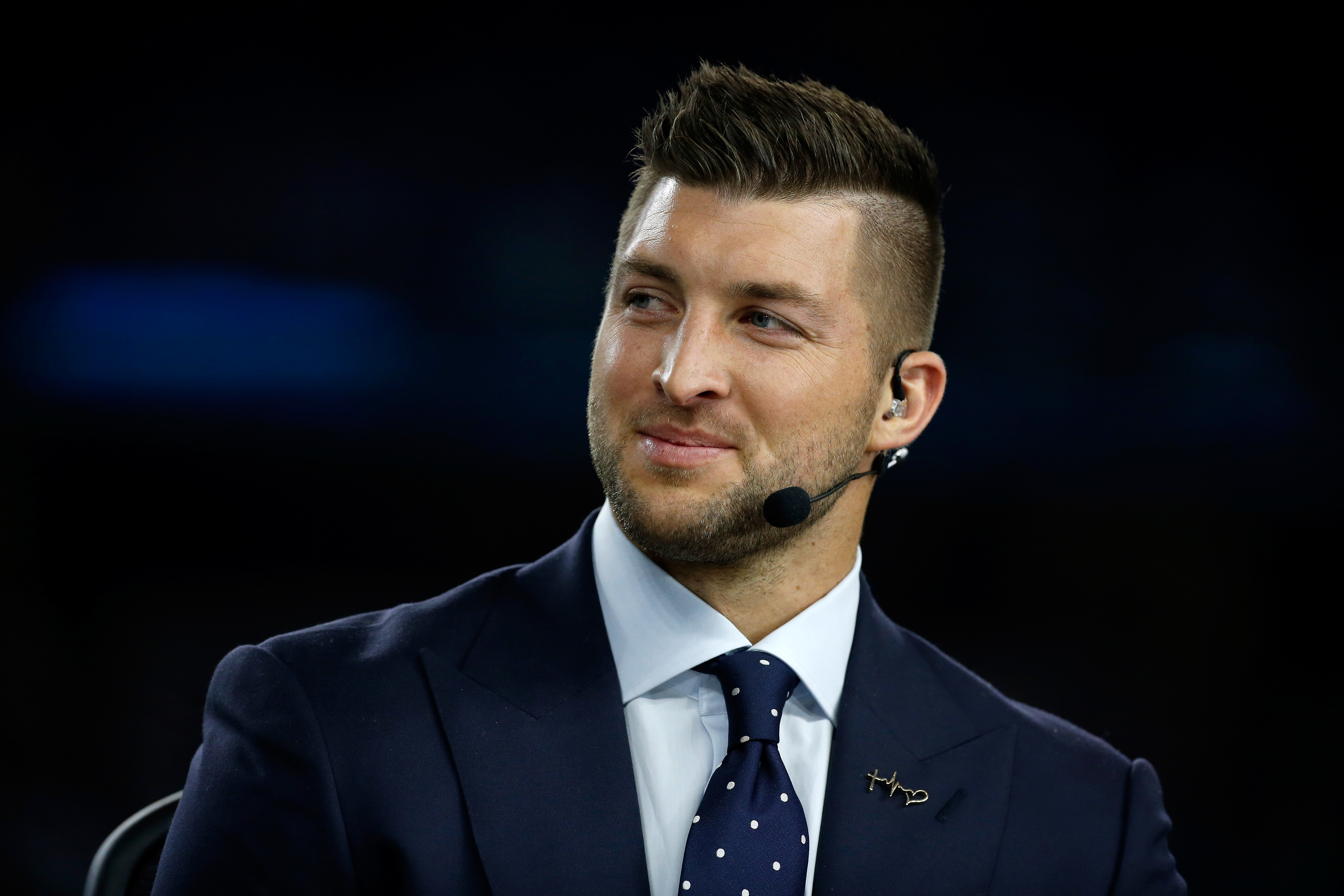 ARLINGTON, TX - DECEMBER 31:  Broadcaster Tim Tebow of the SEC Network speaks on air before the Goodyear Cotton Bowl at AT&T Stadium on December 31, 2015 in Arlington, Texas.  (Photo by Scott Halleran/Getty Images)
