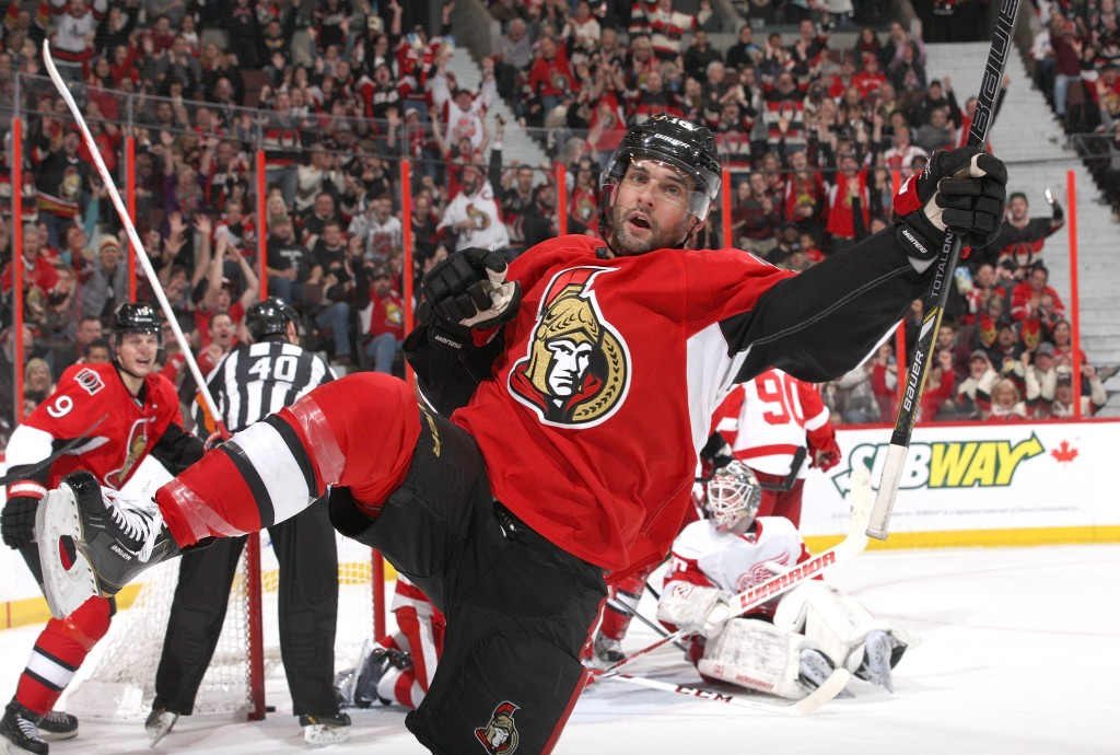 OTTAWA, ON - DECEMBER 1: Clarke MacArthur #16 of the Ottawa Senators celebrates his second period goal against the Detroit Red Wings during an NHL game at Canadian Tire Centre on December 1, 2013 in Ottawa, Ontario, Canada. (Photo by Jana Chytilova/Freestyle Photography/Getty Images)