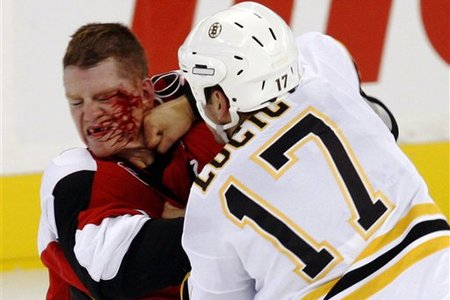 Milan Lucic messes up Chris Neil's face