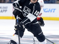 LOS ANGELES, CA - JANUARY 19:  Mike Richards #10 of the Los Angeles Kings reacts to a high stick from Jiri Hudler #24 of the Calgary Flames resulting in a penalty during the second period at Staples Center on January 19, 2015 in Los Angeles, California.  (Photo by Harry How/Getty Images)