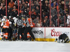 PHILADELPHIA, PA - JANUARY 20: The Pittsburgh Penguins and Philadelphia Flyers mix it up in the corner as Kris Letang #58 of the Pittsburgh Penguins lays injured on the ice at the Wells Fargo Center on January 20, 2015 in Philadelphia, Pennsylvania. (Photo by Drew Hallowell/Getty Images)
