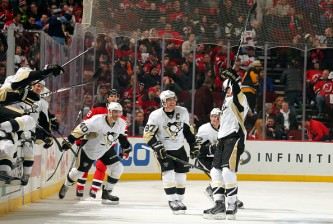NEWARK, NJ - JANUARY 30: Simon Despres #47 of the Pittsburgh Penguins (R) celebrates with Sidney Crosby #87 of the Pittsburgh Penguins and teammates after scoring the game winning goal against the New Jersey Devils in overtime  at the Prudential Center on January 30, 2015 in Newark, New Jersey. (Photo by Adam Hunger/Getty Images)