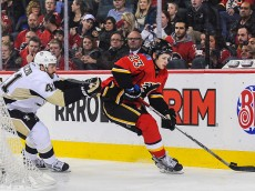 CALGARY, AB - FEBRUARY 6: Sean Monahan #23 of the Calgary Flames skates with the puck past Robert Bortuzzo #41 of the Pittsburgh Penguins during an NHL game at Scotiabank Saddledome on February 6, 2015 in Calgary, Alberta, Canada. The Penguins defeated the Flames 4-0. (Photo by Derek Leung/Getty Images)