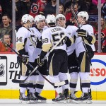 CALGARY, AB - FEBRUARY 6: David Perron #39 (C) of the Pittsburgh Penguins celebrates with his teammates after scoring against the Calgary Flames during an NHL game at Scotiabank Saddledome on February 6, 2015 in Calgary, Alberta, Canada. (Photo by Derek Leung/Getty Images)