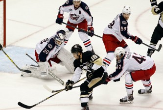 PITTSBURGH, PA - MARCH 01:  Brandon Sutter #16 of the Pittsburgh Penguins handles the puck in front of goaltender Curtis McElhinney #30 of the Columbus Blue Jackets and Artem Anisimov #42 during the game at Consol Energy Center on March 1, 2015 in Pittsburgh, Pennsylvania.  (Photo by Justin K. Aller/Getty Images)