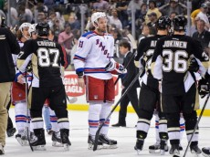 PITTSBURGH, PA - MAY 13:  Rick Nash #61 of the New York Rangers shakes hands with the Pittsburgh Penguins after Game Seven of the Second Round of the 2014 NHL Stanley Cup Playoffs on May 13, 2014 at CONSOL Energy Center in Pittsburgh, Pennsylvania.  (Photo by Jamie Sabau/Getty Images)