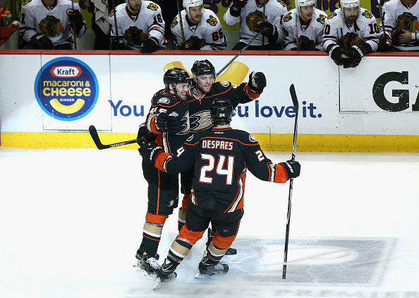 ANAHEIM, CA - MAY 25:  Cam Fowler #4 of the Anaheim Ducks celebrates his first period goal against the Chicago Blackhawks with teammates Sami Vatanen #45 and Simon Despres #24 in Game Five of the Western Conference Finals during the 2015 NHL Stanley Cup Playoffs at Honda Center on May 25, 2015 in Anaheim, California.  (Photo by Stephen Dunn/Getty Images)