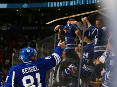 TORONTO, ON - APRIL 11: Phil Kessel #81of the Toronto Maple Leafs throws a stick into the crowd after losing to the Montreal Canadiens in their last game of the year during NHL action at the Air Canada Centre April 11, 2015 in Toronto, Ontario, Canada.  (Photo by Abelimages/Getty Images)