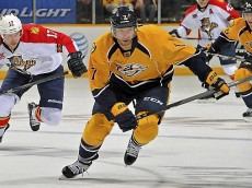 Nashville's Matt Cullen skates against Florida's Jesse Winchester, left, at Bridgestone Arena on October 15, 2013 in Nashville, Tennessee.  (Photo by Frederick Breedon/Getty Images)