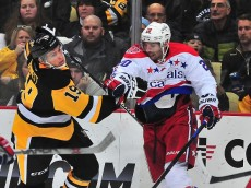 PITTSBURGH, PA - FEBRUARY 17: Troy Brouwer #20 of the Washington Capitals knocks down Beau Bennett #19 during a game against the Pittsburgh Penguins at Consol Energy Center on February 17, 2015 in Pittsburgh, Pennsylvania. (Photo by Matt Kincaid/Getty Images)