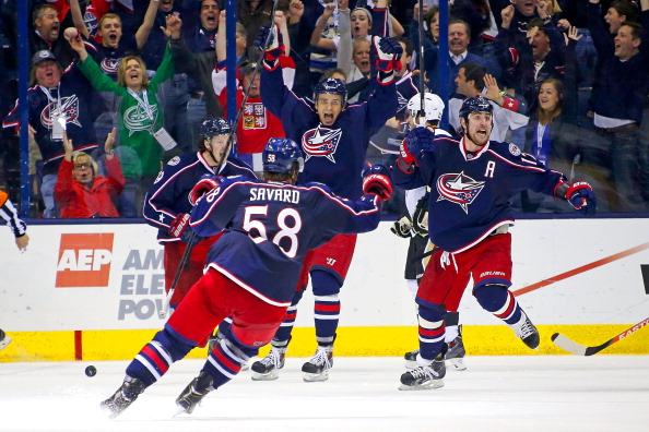 COLUMBUS, OH - APRIL 23:  David Savard #58, Ryan Johansen #19 and Artem Ansimov #42 react as Brandon Dubinsky #17, all of the Columbus Blue Jackets, celebrates after scoring the game tying goal against the Pittsburgh Penguins during the third period in Game Four of the First Round of the 2014 NHL Stanley Cup Playoffs at Nationwide Arena on April 23, 2014 in Columbus, Ohio. (Photo by Kirk Irwin/Getty Images)