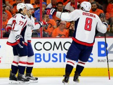 PHILADELPHIA, PA - APRIL 18:  Marcus Johansson #90 of the Washington Capitals is congratulated by teammates T.J. Oshie #77 and Alex Ovechkin #8 after Johansson scored in the first period against the Philadelphia Flyers in Game Three of the Eastern Conference Quarterfinals during the 2016 NHL Stanley Cup Playoffs at Wells Fargo Center on April 18, 2016 in Philadelphia, Pennsylvania.  (Photo by Elsa/Getty Images)