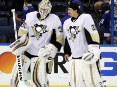 TAMPA, FL - MAY 18:  Matt Murray #30 of the Pittsburgh Penguins celebrates with his teammates Marc-Andre Fleury #29 after defeating the Tampa Bay Lightning in Game Three of the Eastern Conference Final with a score of 4 to 2 during the 2016 NHL Stanley Cup Playoffs at Amalie Arena on May 18, 2016 in Tampa, Florida.  (Photo by Bruce Bennett/Getty Images)