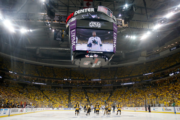 PITTSBURGH, PA - MAY 30: The Pittsburgh Penguins and the San Jose Sharks stand on the ice during player introductions prior to Game One of the 2016 NHL Stanley Cup Final at Consol Energy Center on May 30, 2016 in Pittsburgh, Pennsylvania. (Photo by Justin K. Aller/Getty Images)
