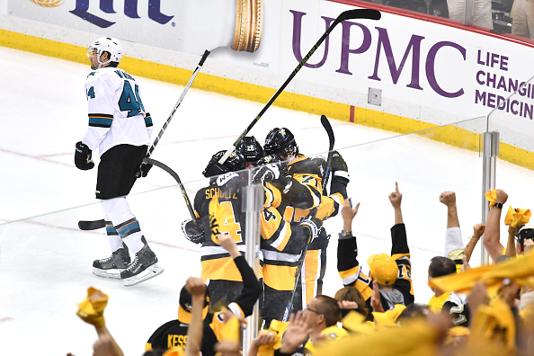 PITTSBURGH, PA - MAY 30:  Bryan Rust #17 of the Pittsburgh Penguins celebrates with Justin Schultz #4, Evgeni Malkin #71, and Ian Cole #28 after scoring a first period goal against the San Jose Sharks in Game One of the 2016 NHL Stanley Cup Final at Consol Energy Center on May 30, 2016 in Pittsburgh, Pennsylvania.  (Photo by Jamie Sabau/Getty Images)