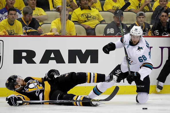 PITTSBURGH, PA - MAY 30:  Ian Cole #28 of the Pittsburgh Penguins falls to the ice against Melker Karlsson #68 of the San Jose Sharks during the second period in Game One of the 2016 NHL Stanley Cup Final at Consol Energy Center on May 30, 2016 in Pittsburgh, Pennsylvania.  (Photo by Bruce Bennett/Getty Images)