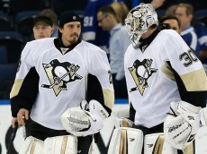 TAMPA, FL - MAY 24:  Matt Murray #30 of the Pittsburgh Penguins celebrates with his teammate Marc-Andre Fleury #29 after defeating the Tampa Bay Lightning in Game Six of the Eastern Conference Final with a score of 5 to 2 during the 2016 NHL Stanley Cup Playoffs at Amalie Arena on May 24, 2016 in Tampa, Florida.  (Photo by Mike Carlson/Getty Images)