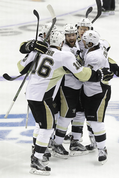 SAN JOSE, CA - JUNE 04: Ben Lovejoy #12 of the Pittsburgh Penguins celebrates with his teammates after scoring during the first period against the San Jose Sharks in Game Three of the 2016 NHL Stanley Cup Final at SAP Center on June 4, 2016 in San Jose, California. (Photo by Ronald Martinez/Getty Images)