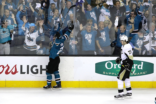SAN JOSE, CA - JUNE 04: Joonas Donskoi #27 of the San Jose Sharks celebrates his game winning goal in front of Evgeni Malkin #71 of the Pittsburgh Penguins during overtime in Game Three of the 2016 NHL Stanley Cup Final at SAP Center on June 4, 2016 in San Jose, California. (Photo by Ezra Shaw/Getty Images)
