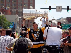 PITTSBURGH, PA - JUNE 15:  Evgeni Malkin #71 of the Pittsburgh Penguins celebrates during the Victory Parade and Rally on June 15, 2016 in Pittsburgh, Pennsylvania.  (Photo by Justin K. Aller/Getty Images)