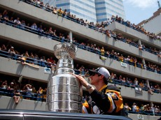 PITTSBURGH, PA - JUNE 15:  Sidney Crosby #87 of the Pittsburgh Penguins celebrates during the Victory Parade and Rally on June 15, 2016 in Pittsburgh, Pennsylvania.  (Photo by Justin K. Aller/Getty Images)