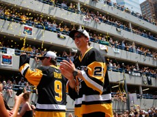 PITTSBURGH, PA - JUNE 15:  Marc-Andre Fleury #29 and  Pascal Dupuis #9 of the Pittsburgh Penguins celebrate during the Victory Parade and Rally on June 15, 2016 in Pittsburgh, Pennsylvania. The Penguins defeated the San Jose Sharks to win the NHL Stanley Cup. (Photo by Justin K. Aller/Getty Images)