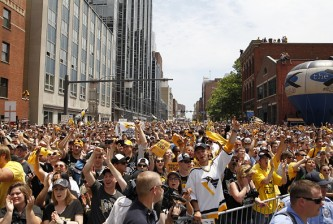 PITTSBURGH, PA - JUNE 15:  Penguins fans celebrate during the Victory Parade and Rally on June 15, 2016 in Pittsburgh, Pennsylvania. The Penguins defeated the San Jose Sharks to win the NHL Stanley Cup. (Photo by Justin K. Aller/Getty Images)