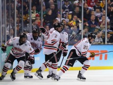 BOSTON, MA - APRIL 09:  Jake Guentzel #20 of the Nebraska-Omaha Mavericks, right, celebrates with teammates after scoring against the Providence Friars during the third period of the 2015 NCAA Division I Men's Hockey Championship semifinals at TD Garden on April 9, 2015 in Boston, Massachusetts.The Providence Friars defeat the Nebraska-Omaha Mavericks 4-1.  (Photo by Maddie Meyer/Getty Images)