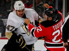 NEWARK, NJ - MARCH 06:  Tom Sestito #47 of the Pittsburgh Penguins and Jordin Tootoo #22 of the New Jersey Devils fight in the first period on March 6, 2016 at Prudential Center in Newark, New Jersey.  (Photo by Elsa/Getty Images)