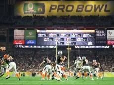 GLENDALE, AZ - JANUARY 25: Team Irvin quarterback Tony Romo #9 of the Dallas Cowboys throws a pass during the first half of the 2015 Pro Bowl at University of Phoenix Stadium on January 25, 2015 in Glendale, Arizona.  (Photo by Christian Petersen/Getty Images)