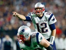 GLENDALE, AZ - FEBRUARY 01:  Tom Brady #12 of the New England Patriots signals in the second half against the Seattle Seahawks during Super Bowl XLIX at University of Phoenix Stadium on February 1, 2015 in Glendale, Arizona.  (Photo by Kevin C. Cox/Getty Images)
