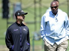 OWINGS MILLS, MD - MAY 05:  Head coach John Harbaugh of the Baltimore Ravens speaks with general manager Ozzie Newsome after a practice during the Baltimore Ravens rookie camp on May 5, 2013 in Owings Mills, Maryland.  (Photo by Patrick McDermott/Getty Images)
