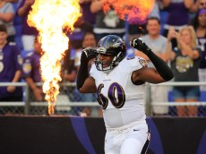 BALTIMORE, MD - AUGUST 07: Tackle Eugene Monroe #60 of the Baltimore Ravens is introduced before the start of an NFL pre-season game against the San Francisco 49ers at M&T Bank Stadium on August 7, 2014 in Baltimore, Maryland.  (Photo by Rob Carr/Getty Images)
