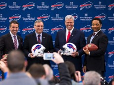 ORCHARD PARK, NY - JANUARY 14: (L to R) Buffalo Bills President Russ Brandon, Owner Terry Pegula, Head Coach Rex Ryan and Manager Doug Whaley pose for photos at a press conference announcing Rex Ryan's arrival as head coach of the Buffalo Bills on January 14, 2015 at Ralph Wilson Stadium in Orchard Park, New York. (Photo by Brett Carlsen/Getty Images)