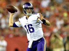KANSAS CITY, MO - AUGUST 23: Matt Cassel #16 of the Minnesota Vikings looks to pass agianst the Kansas City Chiefs defense at Arrowhead Stadium on August 23, 2014 in Kansas City, Missouri.  (Photo by Peter Aiken/Getty Images)