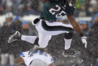 PHILADELPHIA, PA - DECEMBER 8: Running back LeSean McCoy #25 of the Philadelphia Eagles hurdles safety Louis Delmas #26 of the Detroit Lions for a 40 yard run for a touchdown in the third quarter during a game at Lincoln Financial Field on December 8, 2013 in Philadelphia, Pennsylvania. (Photo by Rich Schultz /Getty Images)