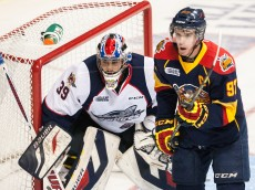 WINDSOR, ON - SEPTEMBER 26: Connor McDavid #97 of the Erie Otters battles for the puck in front of the net against Alex Fotinos #39 of the Windsor Spitfires on September 26, 2014 at the WFCU Centre in Windsor, Ontario, Canada. (Photo by Dennis Pajot/Getty Images)