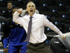NEW YORK, NY - DECEMBER 21: Head coach Bobby Hurley of the Buffalo Bulls reacts against the Manhattan Jaspers during the Brooklyn Hoops Holiday Invitational at Barclays Center on December 21, 2013 in the Brooklyn borough of New York City. (Photo by Adam Hunger/Getty Images)