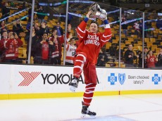 BOSTON, MA - FEBRUARY 23: Jack Eichel #9 of the Boston University Terriers celebrates with the Beanpot trophy following the 4-3 win over the Northeastern Huskies during over time at the 2015 Beanpot Tournament Championship game at TD Garden on February 23, 2015 in Boston, Massachusetts.  (Photo by Maddie Meyer/Getty Images)
