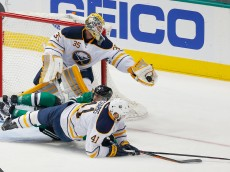 DALLAS, TX - MARCH 23:  Anders Lindback #35 of the Buffalo Sabres blocks a shot as Patrick Eaves #18 of the Dallas Stars is hit by Andrej Meszaros #41 of the Buffalo Sabres in the second period at American Airlines Center on March 23, 2015 in Dallas, Texas.  (Photo by Tom Pennington/Getty Images)