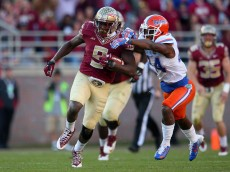 TALLAHASSEE, FL - NOVEMBER 29:  Karlos Williams #9 of the Florida State Seminoles rushes during a game against the Florida Gators  at Doak Campbell Stadium on November 29, 2014 in Tallahassee, Florida.  (Photo by Mike Ehrmann/Getty Images)
